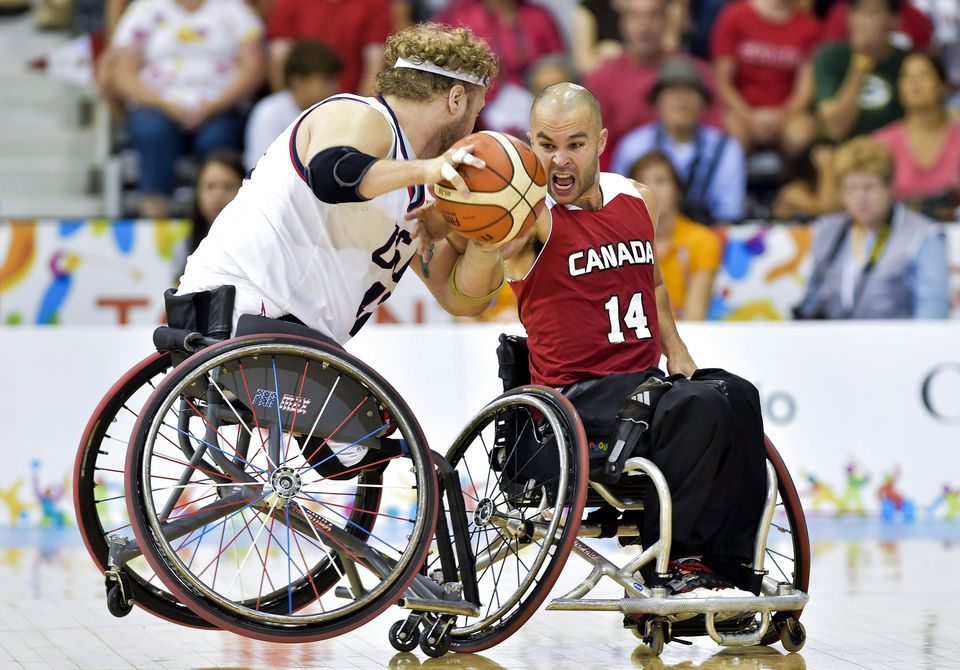 Wheelchair basketball is played at the Paralympic level (above), and the ECAC is bringing it and other adaptive sports to the NCAA.