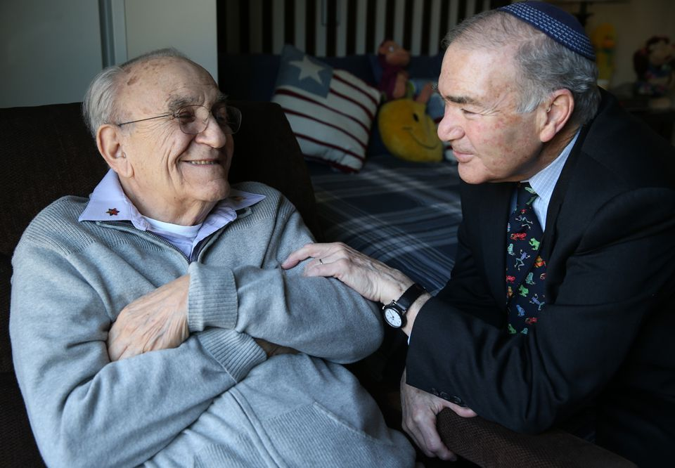 Alan Zuker, who is receiving hospice care and other services at Hebrew SeniorLife in Dedham, is greeted by Rabbi Herman Blumberg.