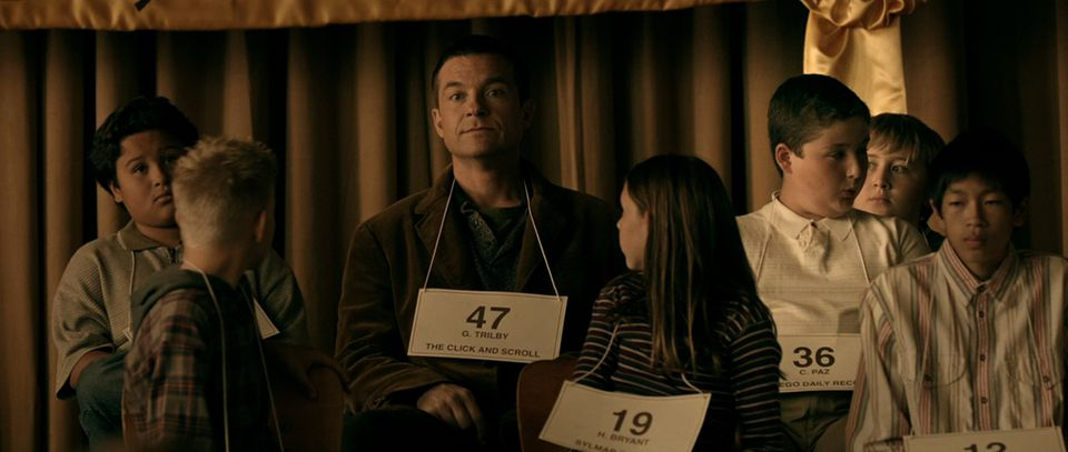 """Jason Bateman (center) in a scene from his directorial debut, """"Bad Words."""""""