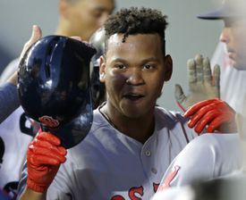 Red Sox teammates congratulated Rafael Devers after he scored his first run in the majors.