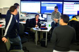 Eric Herot (center), a senior systems administrator, met with colleagues at PayPal's new Boston office Wednesday.