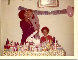A young Daniel Rivera, in the arms of his mother, Eladia Ramos, celebrated at his sister Janet's birthday party.