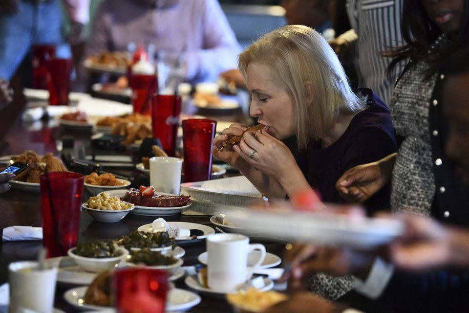 Sen. Kirsten Gillibrand eats at Kiki's Chicken and Waffles in Columbia, S.C., on Feb. 9.