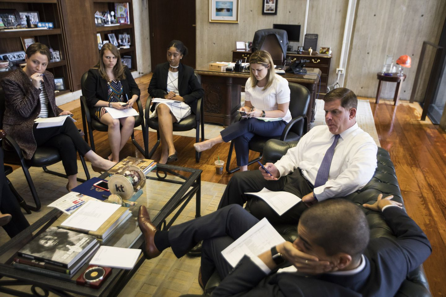 In scheduling  meetings, Walsh's staff figures out how to get him to as many events as possible. Chief of Staff Dan Koh sits to Walsh's left.