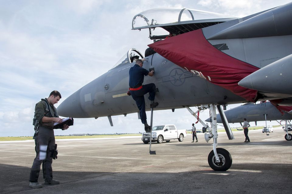 US Air Force Capt. Lance Coldren, an F-15 pilot with the 67th Fighter Squadron, got over a pre-flight checklist at Andersen Air Force Base on Guam.