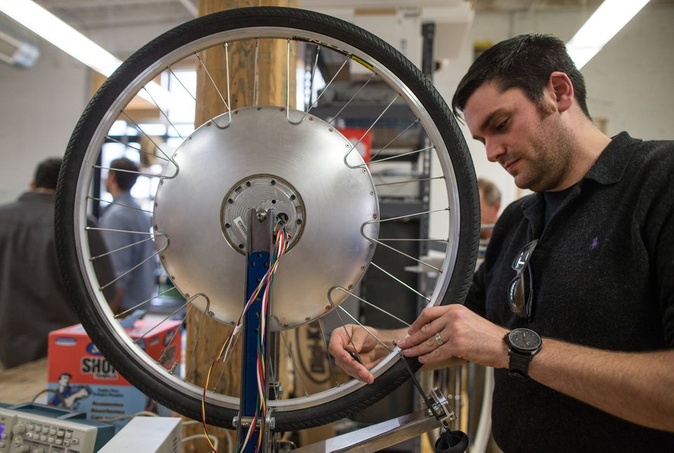 Eric Barber worked on the Copenhagen wheel at Superpedestrian in Cambridge. The sleek wheel is the key to its battery-enhanced bicycle.