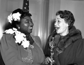 """Hattie McDaniel, left, was given the Oscar award for the best performance of an actress in a supporting role in 1939 for her work as """"Mammy"""" in """"Gone With the Wind."""""""