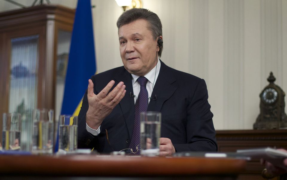 Former Ukrainian President Viktor Yanukovych gestured Wednesday during an interview with The Associated Press in Rostov-on-Don, Russia.