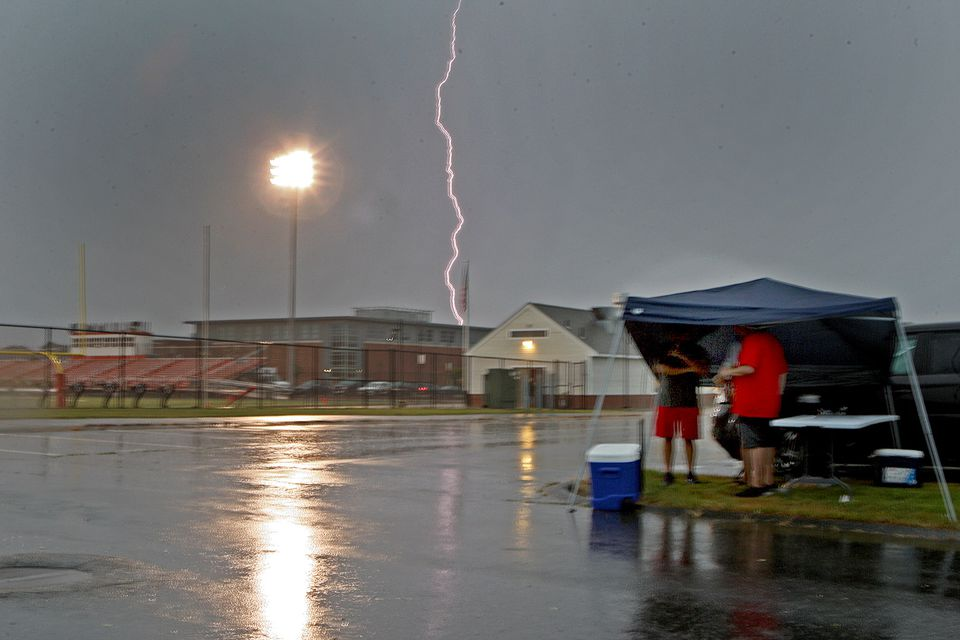 Before Duxbury's deluge of points in its 40-14 season opening win, came the lightning strike, which jolted these fans during their pre-game tailgate.