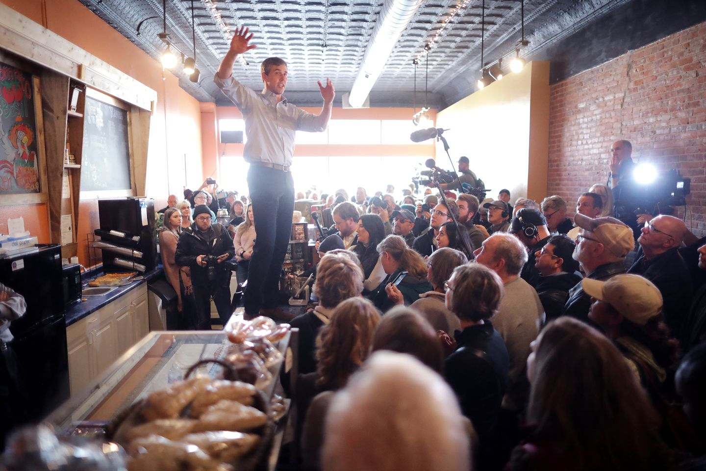 Democratic presidential candidate Beto O'Rourke stood on a countertop at a coffee shop in Mount Pleasant, Iowa, on Friday.