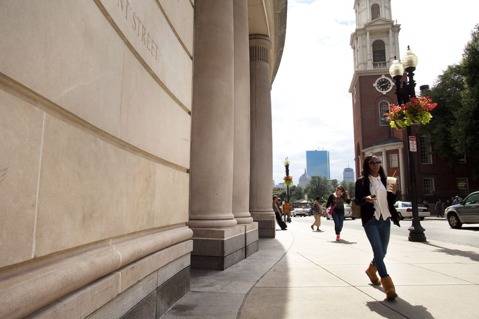 Pedestrians stream past the stately facade of Suffolk University Law School on Tremont Street.