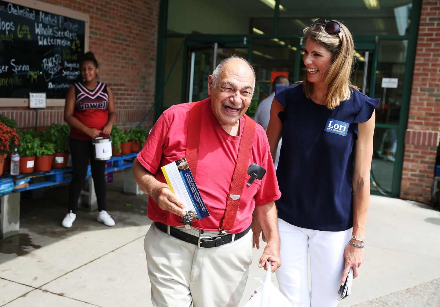 John Stagnon laughed with candidate Lori Trahan while she greeted voters outside of the Chelmsford Market Basket.