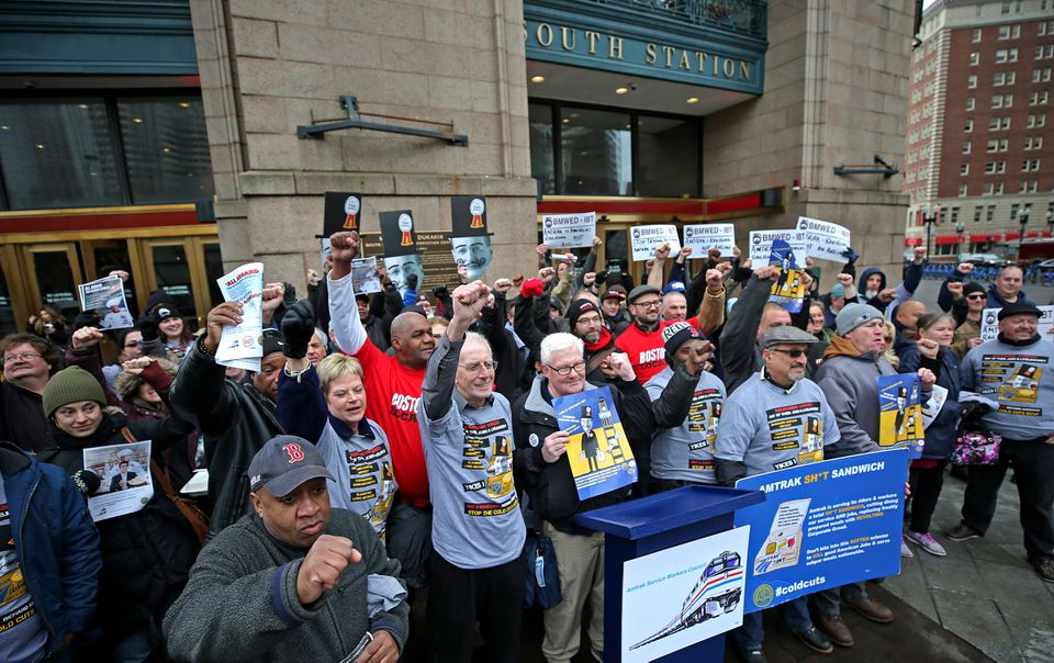 Amtrak workers and their supporters at South Station Monday protested cuts in dining service, and the possible outsourcing of food and beverage jobs.