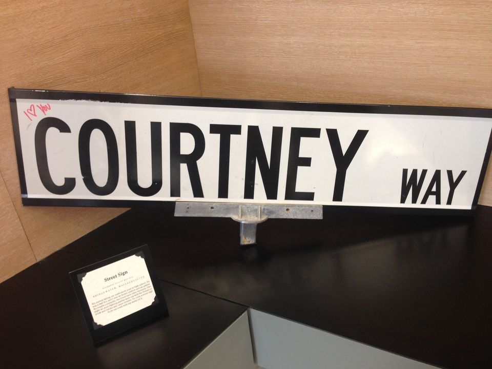 A street sign declares one's love for Courtney.
