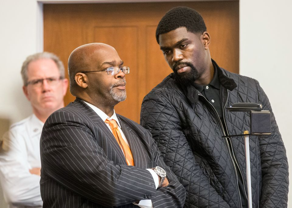 Kyle Pam (right) stood with his attorney, Rudy Miller, in Boston Municipal Court as Pam was arraigned on criminal charges connected with a real estate deal.