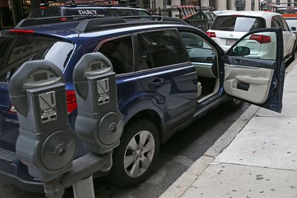 App allows users to claim parking spots, resell them - The Boston Globe