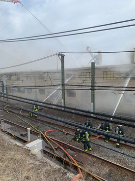 Fire crews took to the Blue Line tracks to pour water on the building.