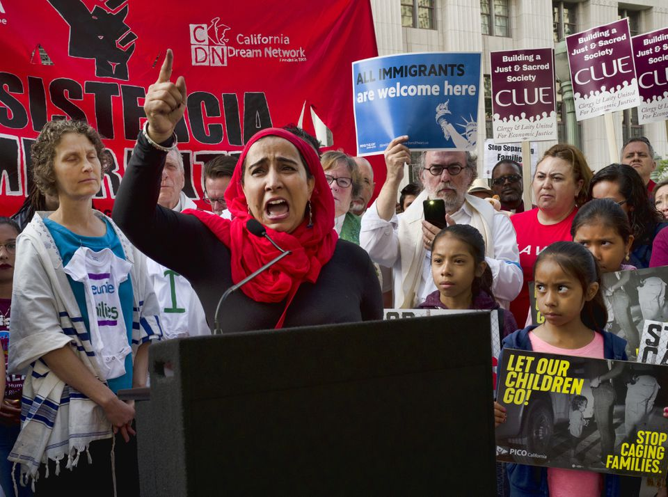 Najeeba Syeed (center) broke down Monday as she talked about children being separated from their parents at the border during a protest in Los Angeles.