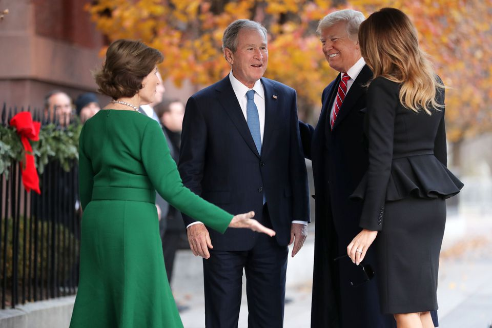 Former first lady Laura Bush and former president George W. Bush greeted President Trump and first lady Melania Trump outside of Blair House on Tuesday.