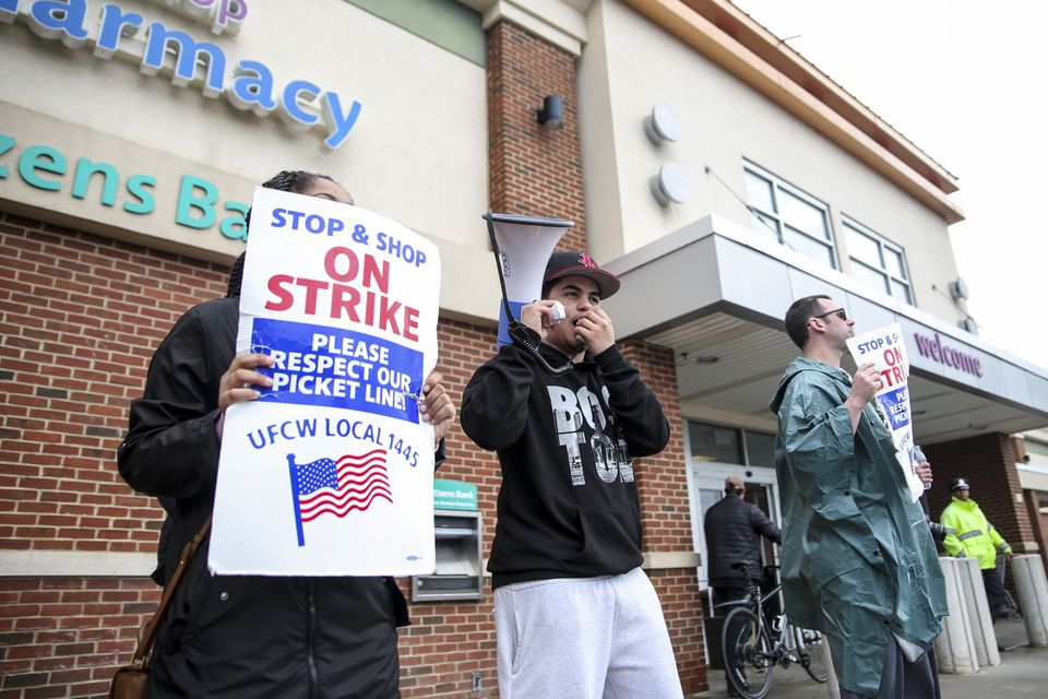Striking workers were outside a Stop & Shop in Dorchester Saturday.