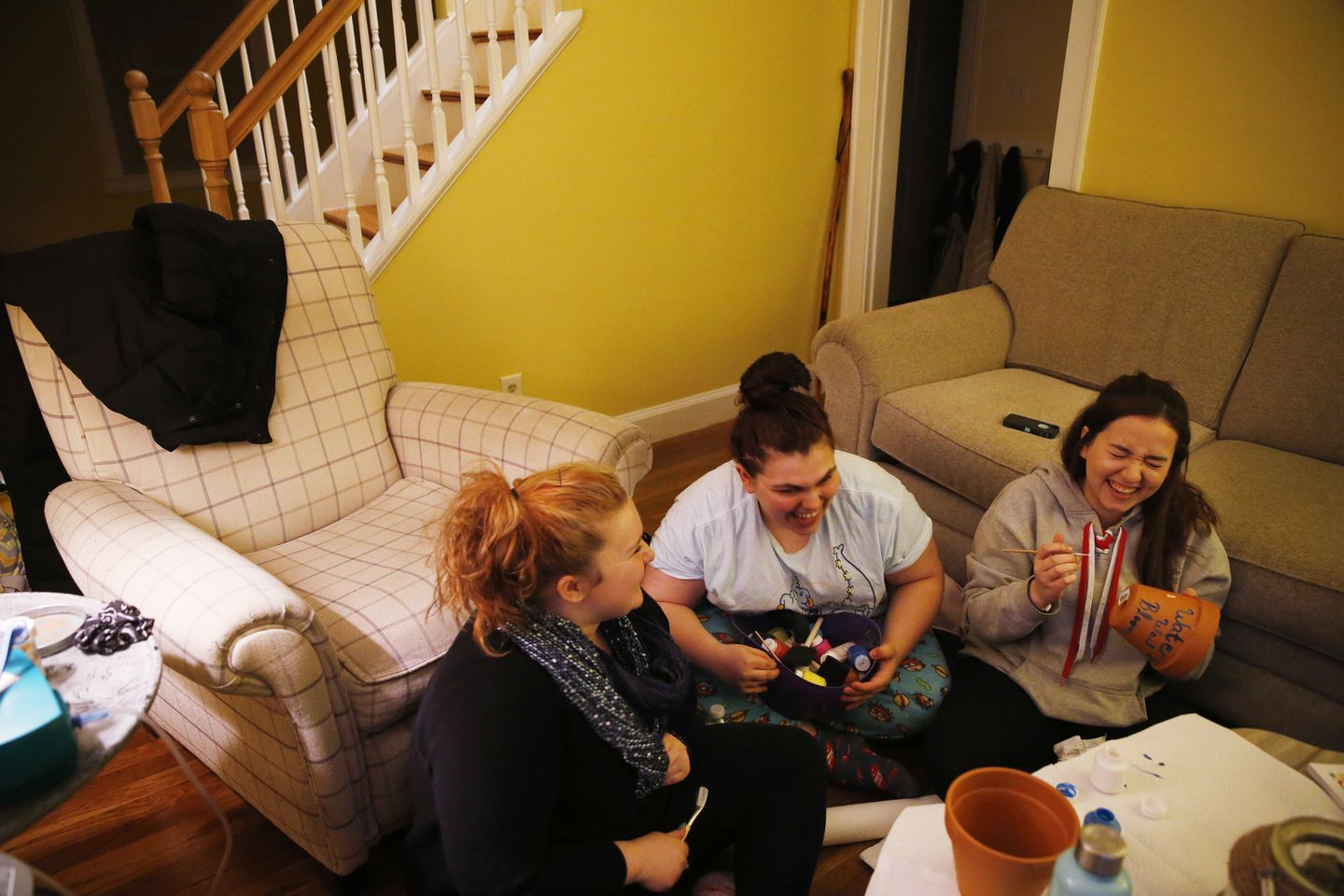 Rachael Carr, Chloe Currier, and Deb joked as they made gifts in Rachael's living room to give to the other teams in the semifinals at Hamilton-Wenham Regional High School.