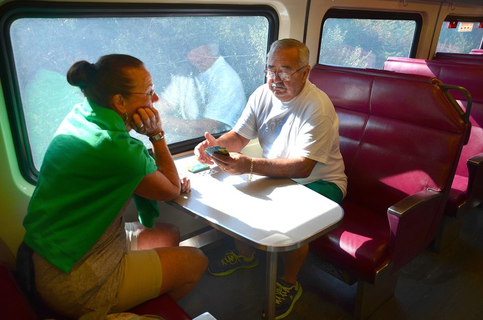 Lee and Richard Drugan of Bourne played cards on the 10:05 a.m. train before it headed out of the commuter rail station in Kingston — and then to Plymouth.
