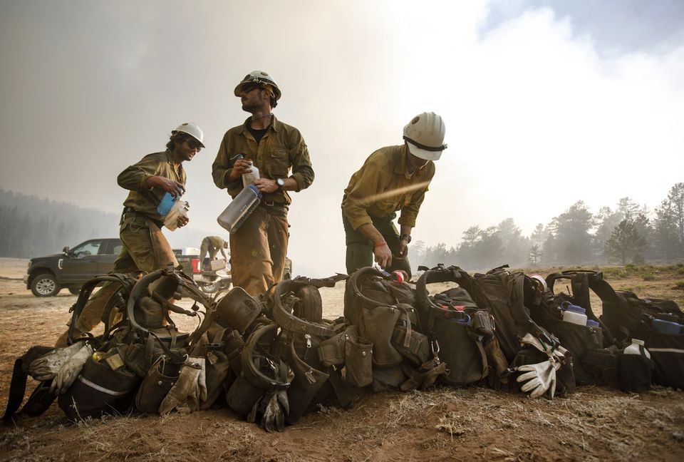 Craig Hotshots firefighters took a break from battling the Weston Pass Fire on Monday near Fairplay, Colo.