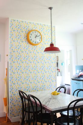 Designer Sally Staub's kitchen features an accent wall covered in wallpaper.