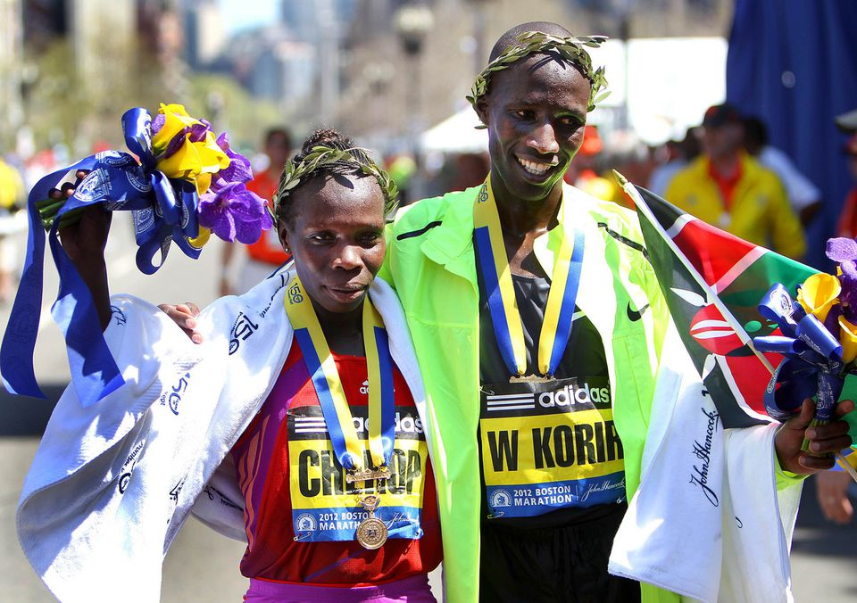 Women's winner Sharon Cherop celebrated with men's winner Wesley Korir at the finish line.