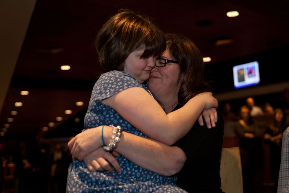 Jane Richard, 9, and Denise Richard shared a moment during the fundraising kickoff for Team MR8.