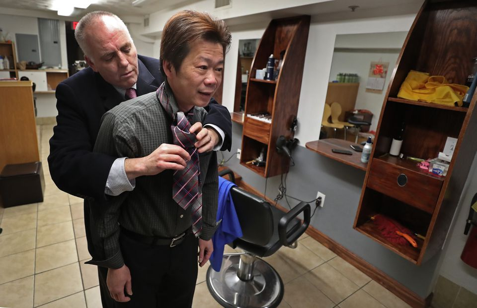 Boston city councilor Ed Flynn helped Yan Chi Chen with his tie before heading to court on Feb. 14.