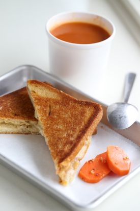 Grilled cheese sandwich with smoky tomato soup.