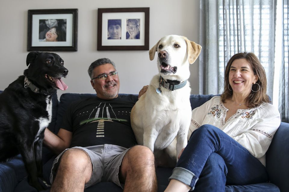 Rick Rodriguez and Gayle Saks, with Lola and Gronk, in their dog-friendly apartment.