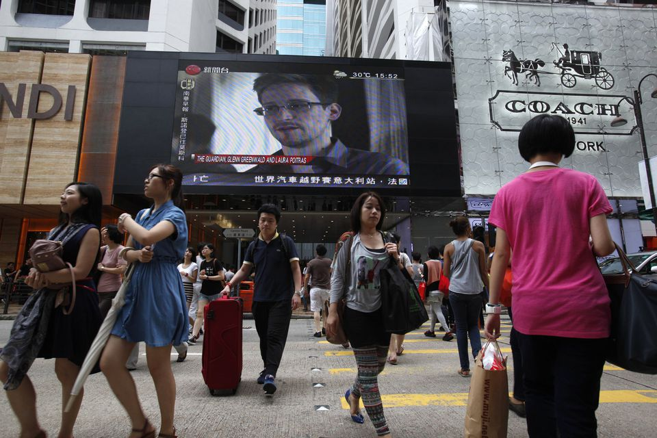 An image of NSA leaker Edward Snowden appeared on a screen by a shopping mall in Hong Kong after he fled to Moscow.
