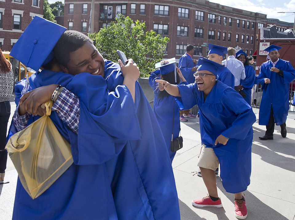 Riccard Berry hugged classmates  before their graduation ceremony at Jeremiah Burke High School on Friday.
