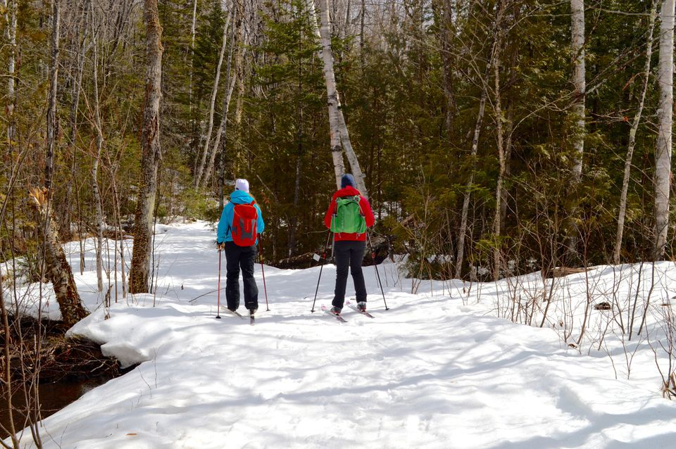 Cross-country skiing on trails in Maine's Carrabasett Valley that are maintained by Maine Huts and Trails.