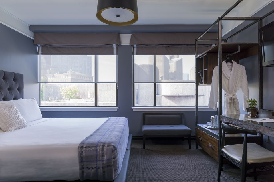 A sleek guest room at the Boxer Boston.