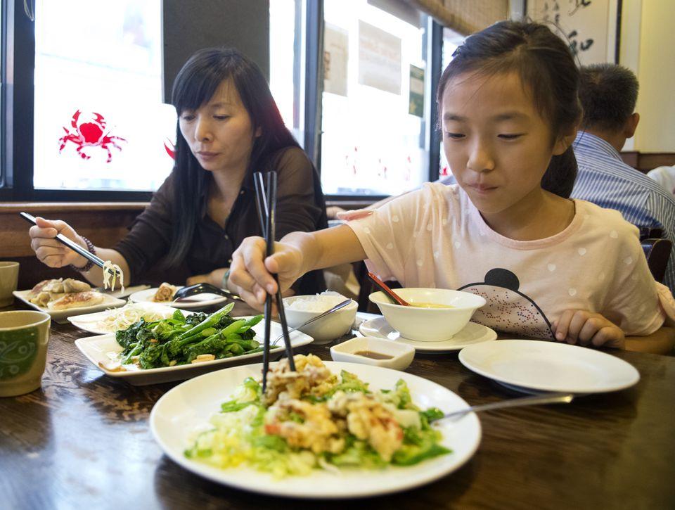 Chen Xin Zi Jie and her mother, Zhang Xiong Wen, dine at Dumpling Cafe.