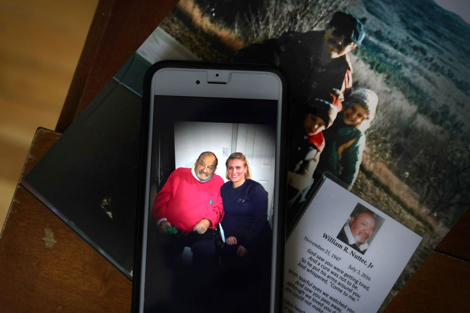 A cellphone photo shows Brigitte Darton as she sits with her father, William Nutter, on a visit, not long before he died.