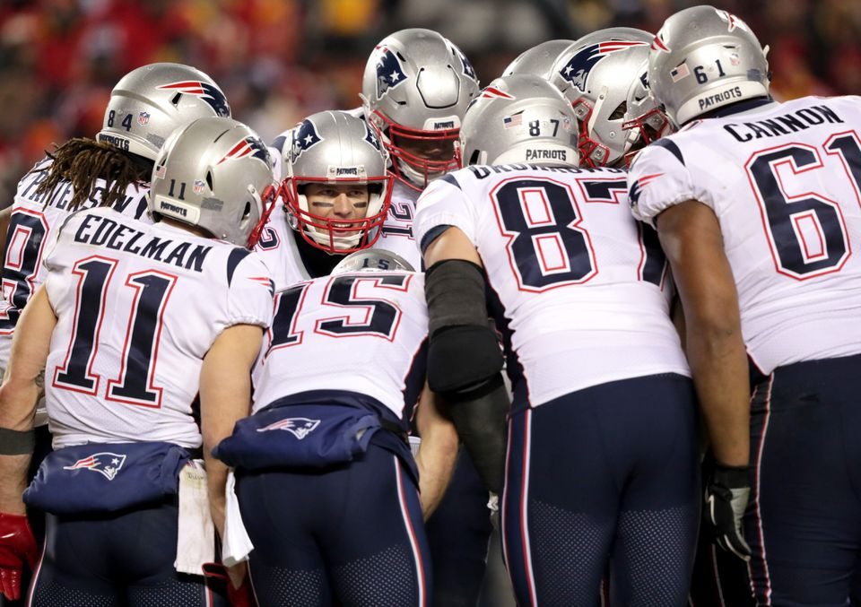 Tom Brady calls a play in the huddle during the fourth quarter of Sunday's AFC Championship.