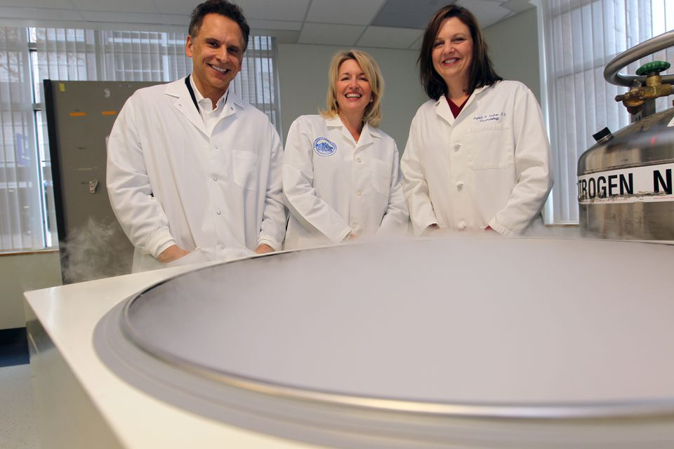 Dr. Jordan W. Smoller, Susan Slaugenhaupt, and Dr. Elizabeth Karlson at the Partners biobank in Kendall Square.