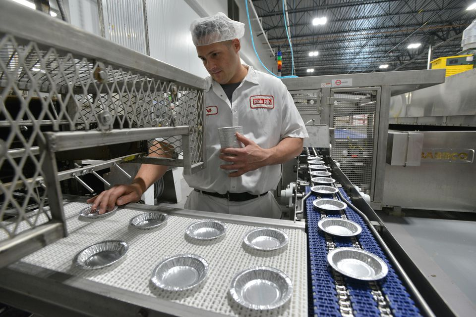 Jeff Warren, product developer for Table Talk, laid out pie tins on the assembly line at the company's new factory in Worcester.