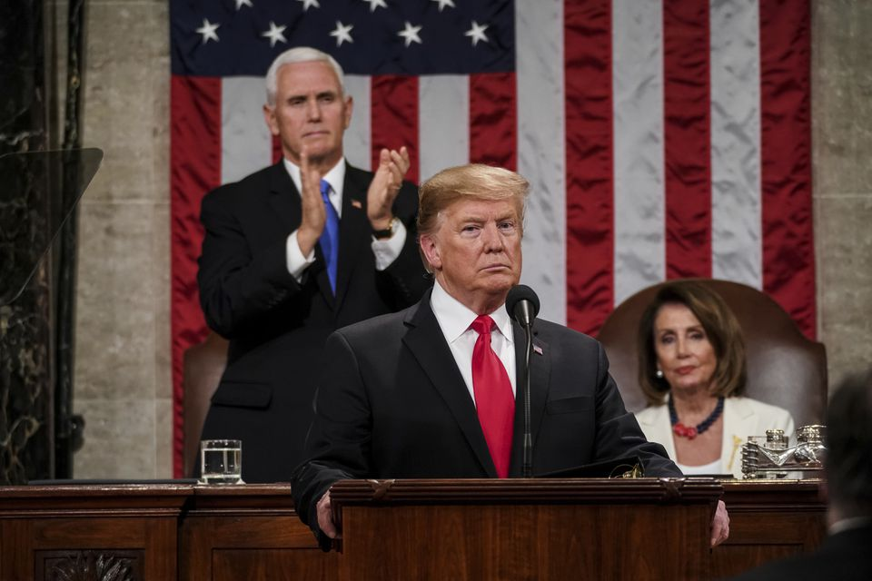 President Trump gives his State of the Union address to a joint session of Congress on Tuesday at the Capitol in Washington, as Vice President Mike Pence and House Speaker Nancy Pelosi look on.