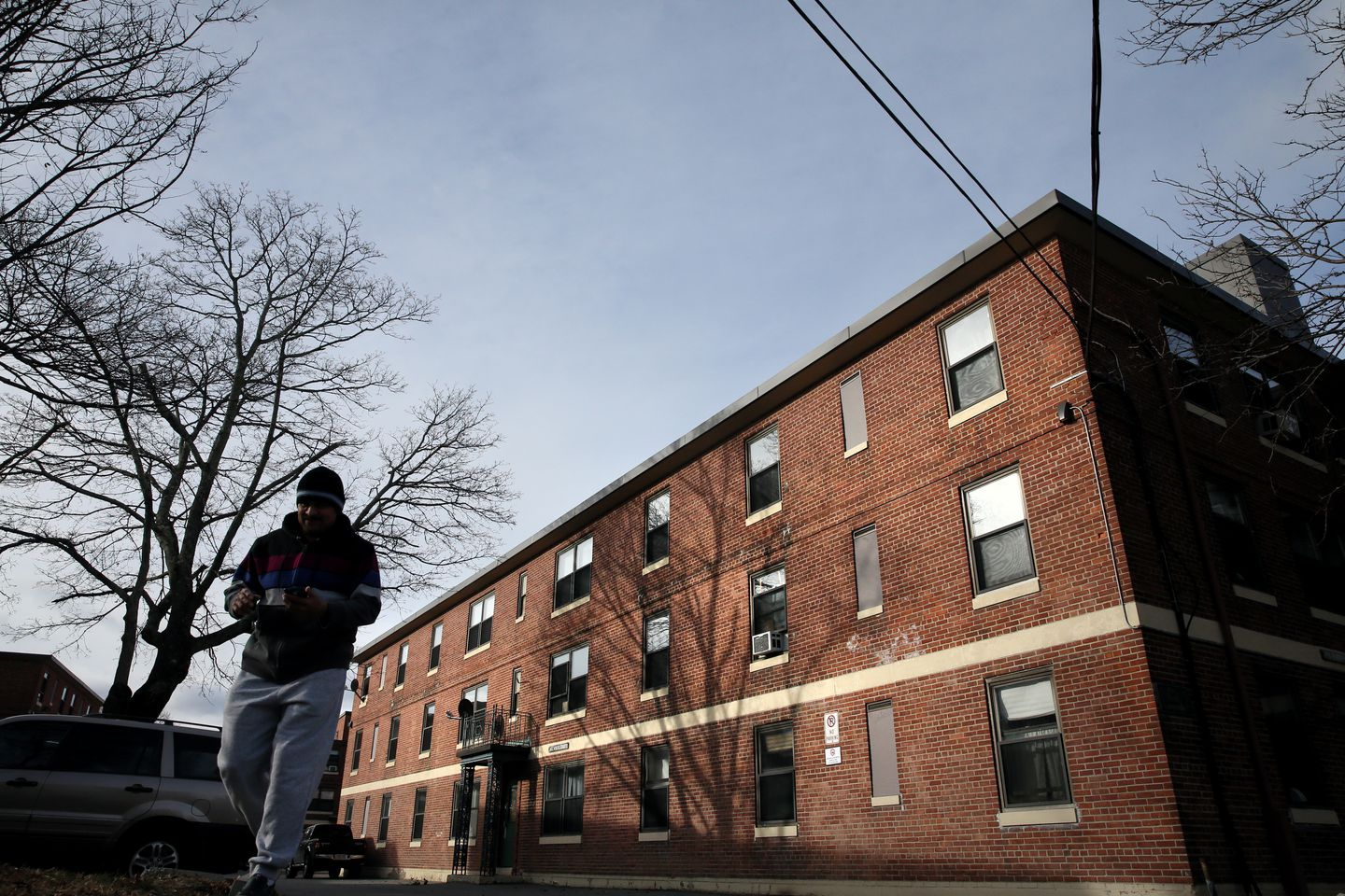 A man departed the Somerville Housing Authority's Clarendon Hill complex where redevelopment plans are on hold.