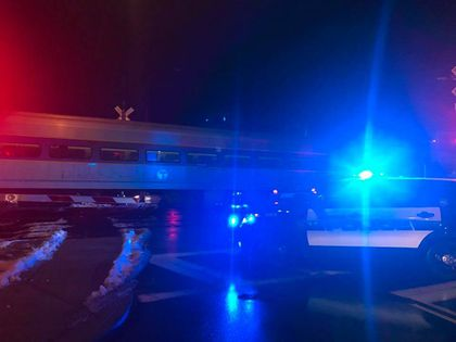 Commuter rail train strikes vehicle on tracks in Andover