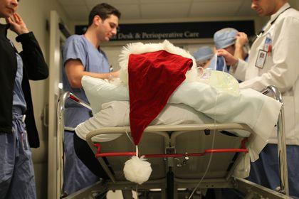 MGH interns give Santa his annual medical workup - The