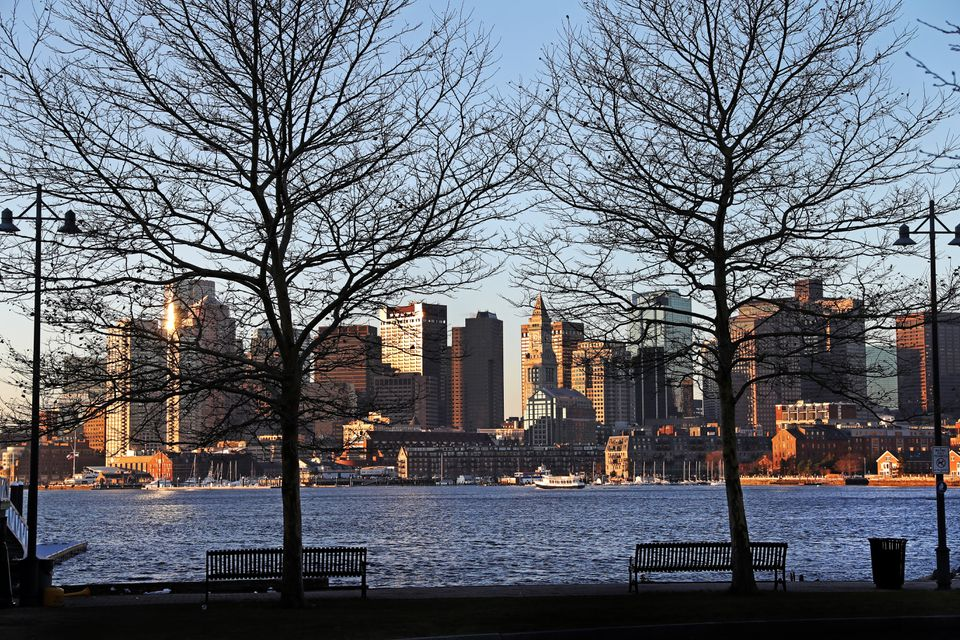 A skyline view of Boston in the early morning seen from East Boston.