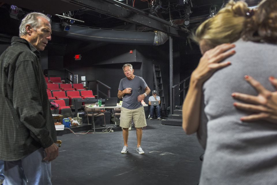"""Playwright and director Israel Horovitz (standing center) in rehearsal for """"Man in Snow"""" with actor Will Lyman (left) and other cast members at Gloucester Stage Company."""