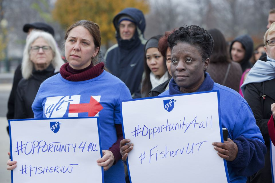 Members of the American Federation of Teachers rally in support of affirmative action outside of the Supreme Court in Washington on Dec. 9, 2015.