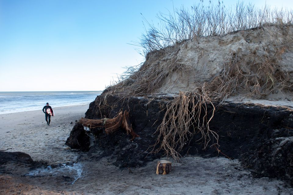 Erosion and a changing landscape are givens on Cape Cod. Above, storm surge ate away at Coast Guard Beach in Eastham in February 2013.